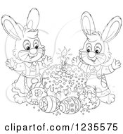 Clipart Of A Black And White Rabbit Couple Around Easter Eggs And A Cake Royalty Free Vector Illustration