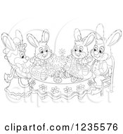 Clipart Of A Black And White Rabbit Family Around Easter Eggs And A Cake Royalty Free Vector Illustration