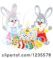 Clipart Of A Gray Rabbit Couple Around Easter Eggs And A Cake Royalty Free Vector Illustration