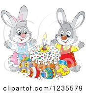Clipart Of A Gray Rabbit Pair Around Easter Eggs And A Cake Royalty Free Vector Illustration