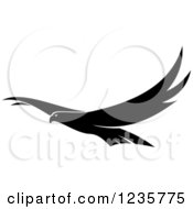 Clipart Of A Black And White Flying Falcon Royalty Free Vector Illustration