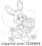 Clipart Of A Black And White Male Easter Bunny Rabbit Carrying An Egg Royalty Free Vector Illustration