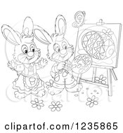 Clipart Of Black And White Easter Bunny Rabbits Painting Eggs On Canvas Royalty Free Vector Illustration