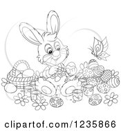 Clipart Of A Black And White Male Easter Bunny Rabbit Painting Eggs Royalty Free Vector Illustration
