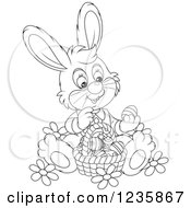 Clipart Of A Black And White Bunny Rabbit Sitting With A Basket Of Easter Eggs Royalty Free Vector Illustration