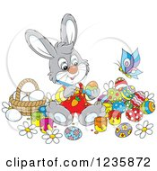 Clipart Of A Gray Male Easter Bunny Rabbit Painting Eggs Royalty Free Vector Illustration