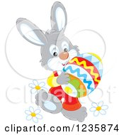 Clipart Of A Gray Male Easter Bunny Carrying An Egg Royalty Free Vector Illustration