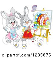 Clipart Of Gray Easter Bunny Rabbits Painting Eggs On Canvas Royalty Free Vector Illustration