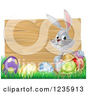 Gray Bunny By A Wood Sign With A Basket Grass And Easter Eggs