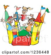 Happy Children Jumping On A Colorful Castle Bouncy House