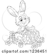 Clipart Of A Black And White Male Bunny Rabbit Painting An Easter Egg In Colorful Patterns Royalty Free Vector Illustration