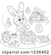 Clipart Of A Black And White Female Bunny Rabbit Decorating An Easter Cake Royalty Free Vector Illustration