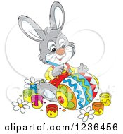 Clipart Of A Gray Male Bunny Painting An Easter Egg In Colorful Patterns Royalty Free Vector Illustration
