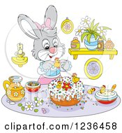 Clipart Of A Gray Female Bunny Decorating An Easter Cake Royalty Free Vector Illustration