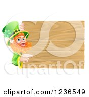 Clipart Of A St Patricks Day Leprechaun Pointing To A Wooden Sign Royalty Free Vector Illustration