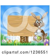 Clipart Of A Brown Bunny By A Posted Wood Sign With A Basket Grass And Easter Eggs Royalty Free Vector Illustration