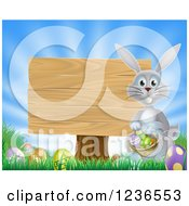 Clipart Of A Gray Bunny By A Posted Wood Sign With A Basket Grass And Easter Eggs Royalty Free Vector Illustration