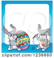 Clipart Of A Blue Border Of Bunny Rabbits Painting An Easter Egg Royalty Free Vector Illustration