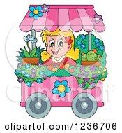 Happy Blond Girl Working At A Flower Shop Florist Cart