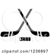 Clipart Of A Black And White Hockey Puck And Crossed Sticks Icon Royalty Free Vector Illustration