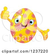 Clipart Of A Happy Yellow Easter Egg With Pink Flowers Royalty Free Vector Illustration
