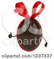 Clipart Of A 3d Chocolate Easter Egg With A Red Bow Holding A Thumb Up Royalty Free Illustration