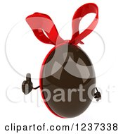 Clipart Of A 3d Chocolate Easter Egg With A Red Bow Holding A Thumb Up 2 Royalty Free Illustration