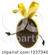 Clipart Of A 3d Pointing Chocolate Easter Egg With A Yellow Bow Royalty Free Illustration