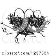 Clipart Of A Woodcut Nest With Eggs Royalty Free Vector Illustration