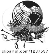 Clipart Of A Woodcut Black And White Earth In A Nest Royalty Free Vector Illustration