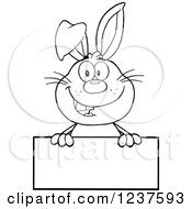 Clipart Of A Black And White Happy Rabbit Over A Blank Sign Royalty Free Vector Illustration