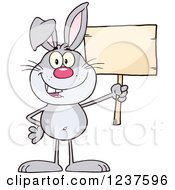 Clipart Of A Happy Gray Rabbit Holding A Wooden Sign Royalty Free Vector Illustration