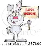 Clipart Of A Gray Easter Bunny Holding A Happy Holidays Sign Royalty Free Vector Illustration