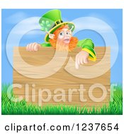 Clipart Of A St Patricks Day Leprechaun Pointing Down To A Wooden Sign Over Grass And Sky Royalty Free Vector Illustration