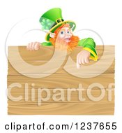 St Patricks Day Leprechaun Pointing Down To A Wooden Sign