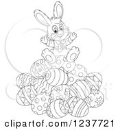 Clipart Of A Black And White Cute Easter Bunny Sitting On A Pile Of Eggs Royalty Free Vector Illustration