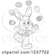 Clipart Of A Black And White Cute Easter Bunny Juggling Eggs Royalty Free Vector Illustration