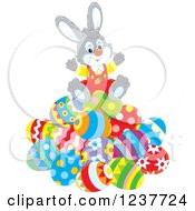 Clipart Of A Cute Gray Easter Bunny Sitting On A Pile Of Eggs Royalty Free Vector Illustration