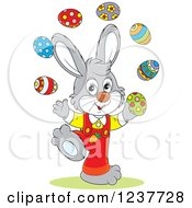 Clipart Of A Cute Talented Gray Easter Bunny Juggling Eggs Royalty Free Vector Illustration