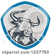 Clipart Of A Retro Angry Bull In A Shield Royalty Free Vector Illustration