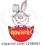 Clipart Of A Gray Rabbit In An Egg Shell With Happy Easter Text Royalty Free Vector Illustration