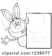 Clipart Of A Black And White Rabbit Waving Around A Blank Sign Royalty Free Vector Illustration