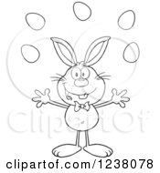 Clipart Of A Black And White Rabbit Juggling Easter Eggs Royalty Free Vector Illustration
