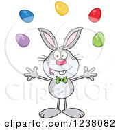 Clipart Of A Gray Rabbit Juggling Easter Eggs Royalty Free Vector Illustration