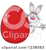 Clipart Of A Gray Rabbit Waving Around A Giant Red Easter Egg Royalty Free Vector Illustration