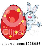 Clipart Of A Blue Rabbit Waving Around A Giant Red Easter Egg Royalty Free Vector Illustration