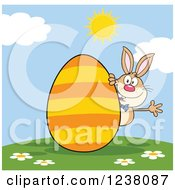Clipart Of A Brown Rabbit Waving On A Hill With A Giant Orange Striped Easter Egg Royalty Free Vector Illustration