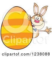 Clipart Of A Brown Rabbit Waving Around A Giant Orange Striped Easter Egg Royalty Free Vector Illustration