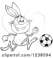 Clipart Of A Black And White Rabbit Playing Soccer Royalty Free Vector Illustration
