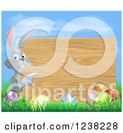 Clipart Of A Wood Sign Easter Bunny With Eggs Grass And Sky Royalty Free Vector Illustration by AtStockIllustration
